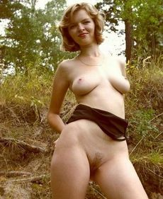 Cute blonde shows off outdoors -..