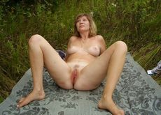 Mature woman spreading her legs..