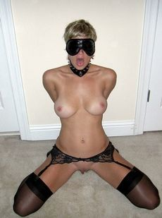 Blindfolded wife with hands behind..