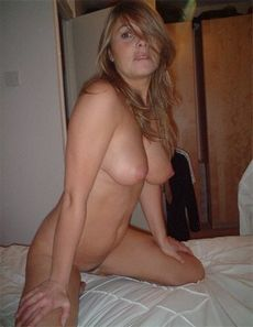 Horny wifey posing naked on the..